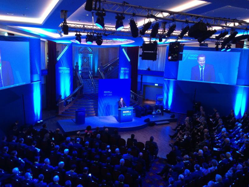 David Cameron on stage at INI Investment Conference headline image
